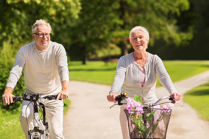 Older couple riding bikes together