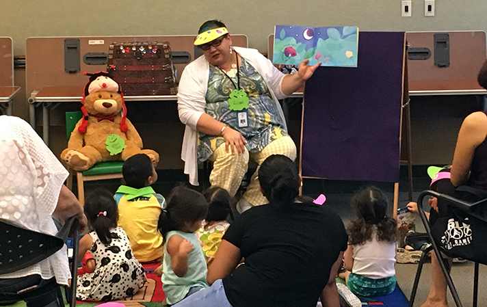 storytime at the Downtown Library - woman reading a book to small children